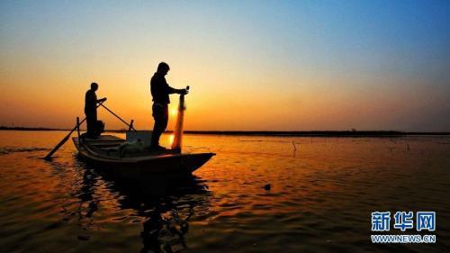 淀上渔家(3月25日摄)。 新华网毛鹤然摄