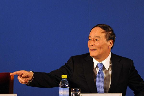 中共两会期间,前中纪委书记王岐山成为媒体关注的焦点。(Getty Images)